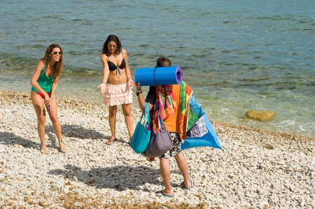 Getting bossy instructions after carrying their stuff to the  beach photo