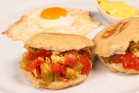 Classic arepa stuffing with scrambled eggs and vegetables, also known as arepa reina photo