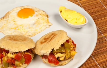 Arepa stuffed with vegetables and scramblesd egg photo
