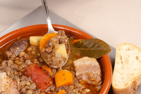 Tasty Spanish lentil stew with a variety of meats photo