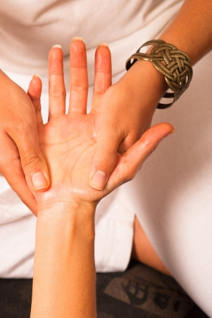 oriental massage: Relaxing massage on the palm of a hand Stock Photo
