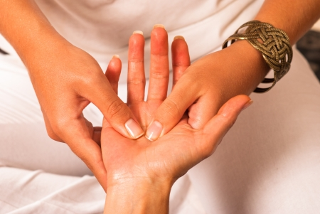 acupressure hands: Closeup of a therapist massaging a hand Stock Photo