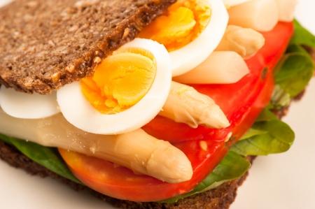 pumpernickel: Pumpernickel style rye bread with a healthy vegetarian fillling Stock Photo