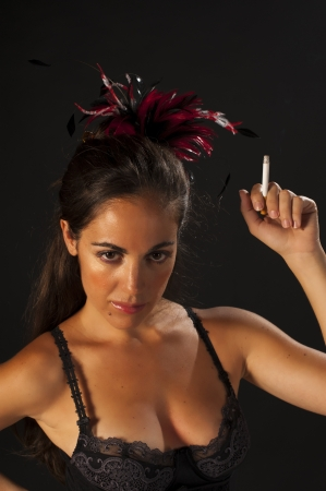 Smoking woman with a  retro cabaret dancer outfit photo