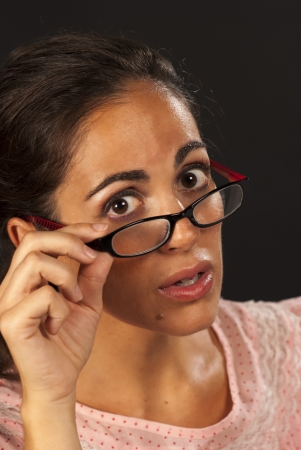 sceptical: A nerd female giving the camera a reproachful look Stock Photo