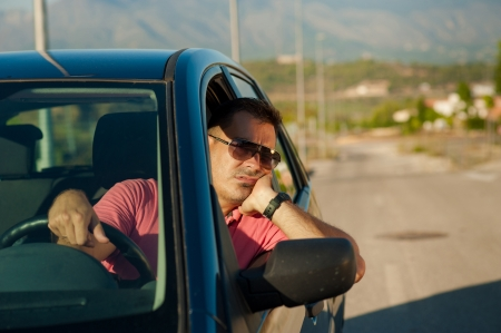 Guy pretty bored while waiting for an open road