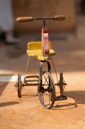 antique tricycle: Vintage wooden tricycle from the beginning of the 20th century