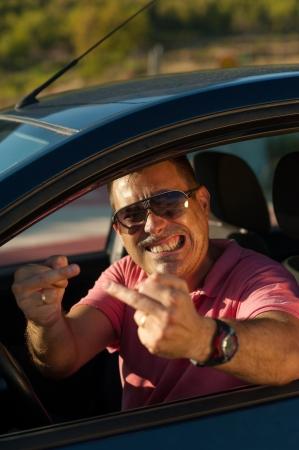 obscene: Pretty upset driver  doing obscene gestures Stock Photo