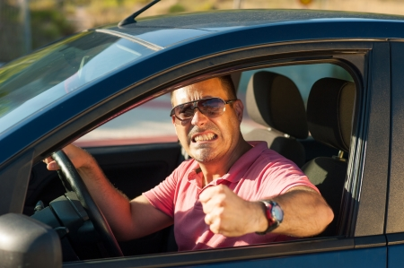 angry person: Macho type of driver about to lose it Stock Photo