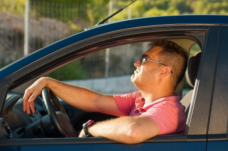 motorist: Latin guy inside his car trying to look cool