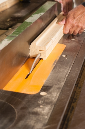 sawing: Carpenter hands working on a sawing tabler
