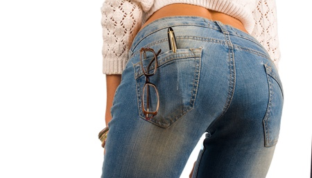 Sexy jeans containing glasses and a fountain pen photo