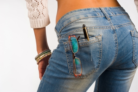 butt tight jeans: Student jeans pocket containing glasses and a pe