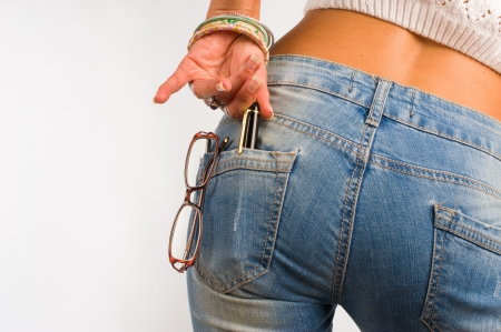 tight fit: Tight fit jeans pocket containing glasses and a pen, a concept