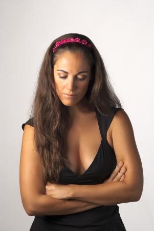 sulky: Arms crossed female in a sulky attitude