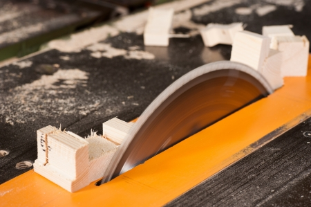 timber cutting: Circular table saw in action in a carpenter workshop