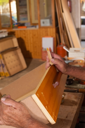 Carpenter hands working at a wooden drawer