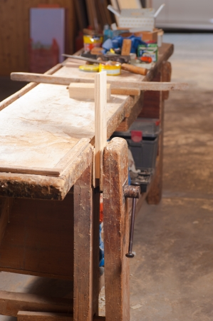 carpenter vise: An old wooden work bench in a carpenter workshop Stock Photo