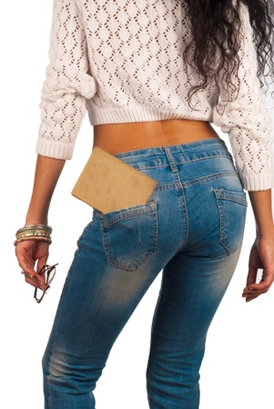 tight jeans: Old book in a tight fitting sexy jeans pocket Stock Photo