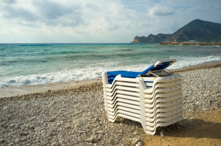 albir: Stormy skies signaling season end on a Mediterranean beach resort Stock Photo