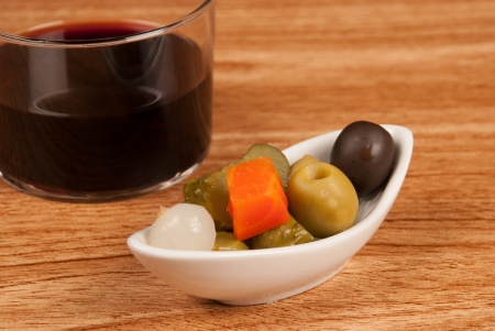 andalusian cuisine: Pickled tapa and a glass of wine on a bar counter, a Spanish classic Stock Photo