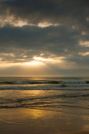 Stormy weather on a sandy beach at sunrise Stock Photo - 15651734