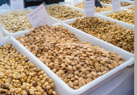 A variation of nuts on display on a street market stall photo