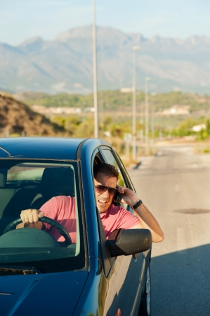 Aggressive guy yelling on the phone whiledriving photo
