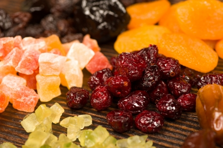 displayed: Assorted dried fruit displayed on an wooden surface Stock Photo