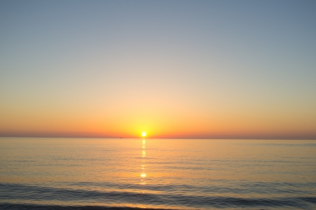 Beautiful sunrise on a calm Mediterraneanbeach Stock Photo - 15766066