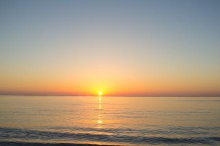 sunset beach: Beautiful sunrise on a calm Mediterraneanbeach