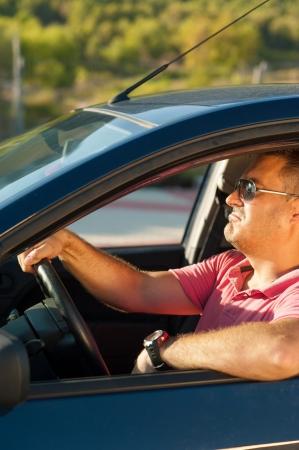 manhood: Male driver in a cool macho attitude