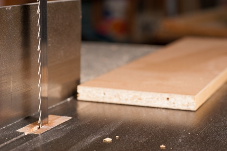 Detail take of a bandsaw against the background of a carpenter workshop Stock Photo - 15820884