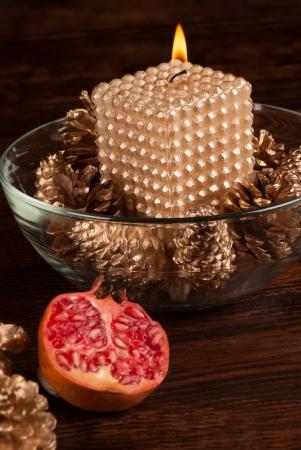 Elegant golden candle amidst Christmas decoration Stock Photo - 15880640