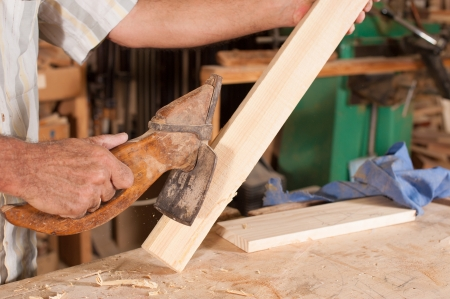 carpenters adze. old adze in carpenters hands carving wood stock photo, picture and royalty free image. image 15882210. l