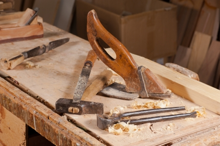Old carpentry tools on a work bench photo