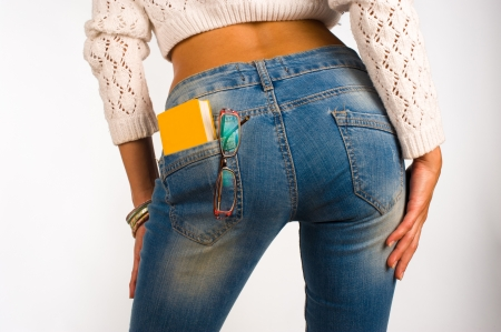 women in jeans: A small dictionary sticking out of  a sexy jeans back pocket Stock Photo