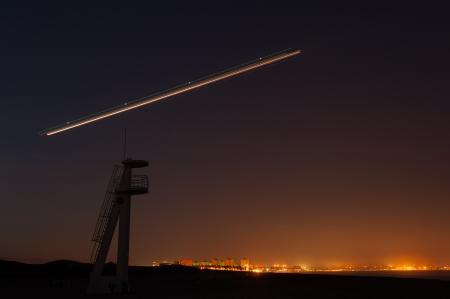 jetliner: Jetliner taking off at night over a Mediterranean resort Stock Photo