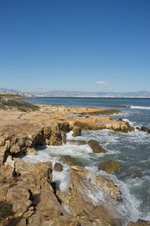 costa blanca: Wild rocky shore near Santa Pola, Costa Blanca, Spain Stock Photo