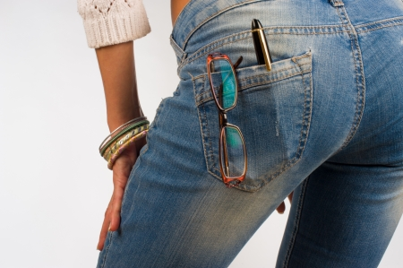 butt tight jeans: Tight fit jeans pocket containing glasses and a pen, a concept