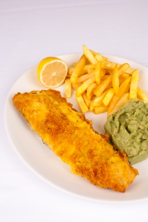 Fish and chips served with mashed potatoes photo