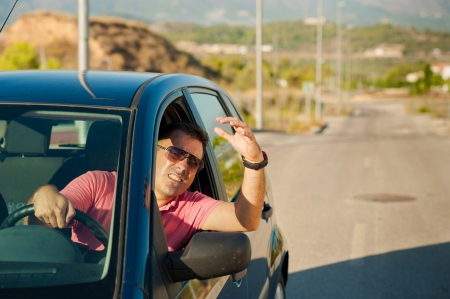 road rage: Guy gesturing out of the window of his car