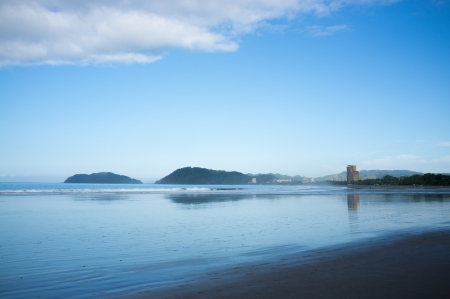 Jaco beach early morning at high tide photo