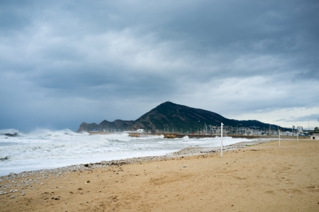 Summer season is over, a resort beach swept by heavy storm Stock Photo - 17181245
