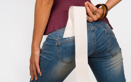 butt tight jeans: Till roll out of jeans pocket, a consumerism concept