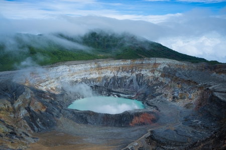 Fumes coming out of the hot Poas volcano lagoon, Costa Rica, Central America Stock Photo