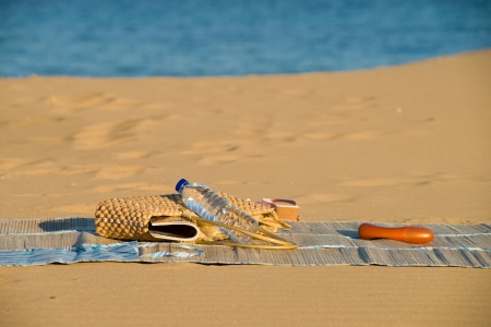 beach mat: A handbag and summer related objects on a beach mat Stock Photo