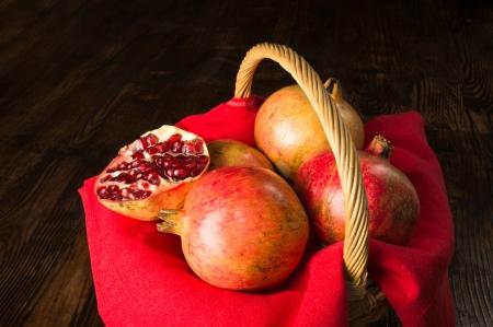 pommegranates: A basket full with ripe pommegranates, a fall still life Stock Photo