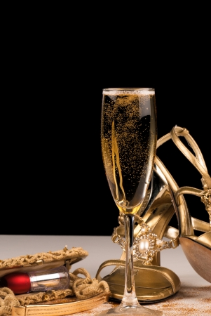high heeled shoe: Champagne and sexy female accessories, party still life