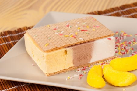 Ice cream sandwich served with colorful candy decoration photo